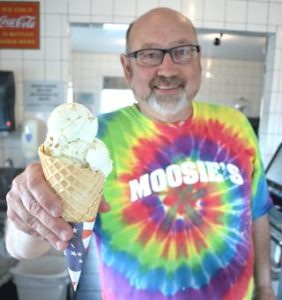 Gary Jensen handing single serve Waffle cone. Moosie's Ice Cream parlor, Medford, WI